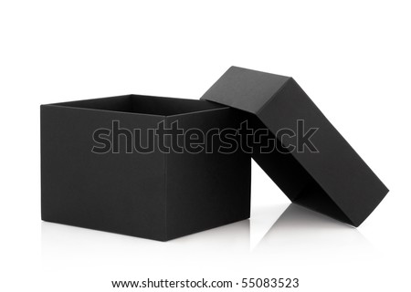Black cardboard box with the lid off over white background with reflection. - stock photo