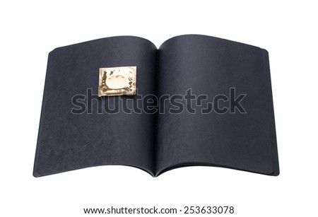 black cardboard notebook with golden condom on a white background - stock photo