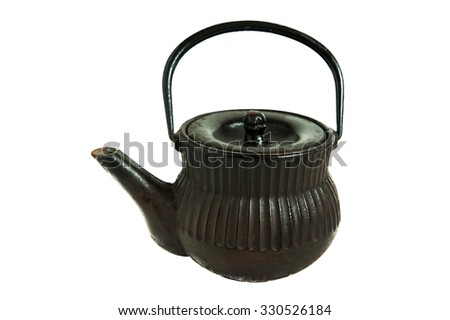 Black cast-iron teapot for making tea leaves and heating in direct fire - stock photo