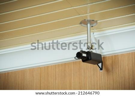 black cctv camera on the wall  - stock photo