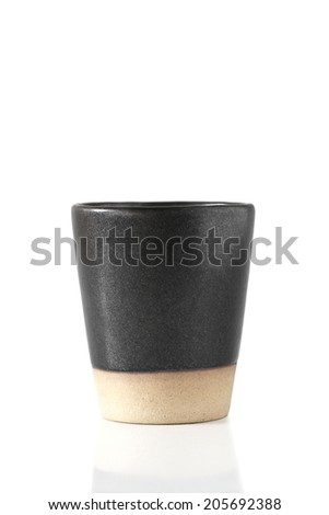 Black ceramic cup - stock photo