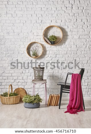 black chair and brick wall decor with round frame - stock photo