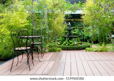 Etonnant Black Chair In Wood Patio At Green Garden With Fountain In House. Outdoor  Garden.