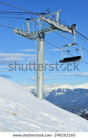 Black Chairlift on Ski Hill in front of Mountain Range, Marmot Basin, Jasper National Park - UNESCO World Heritage