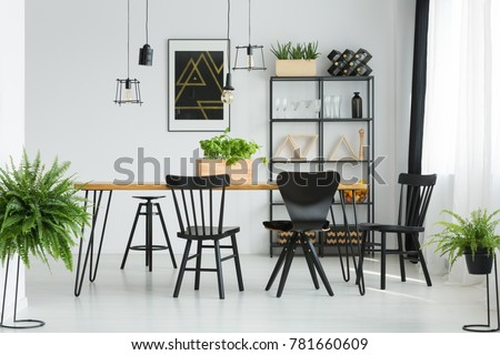 Black Chairs At Dining Table In Bright Room With Ferns And Dark  Poster On White Chairs Dining Table Bright Stock Photo Royalty Free