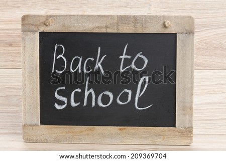 black chalk board with back to school letters - stock photo