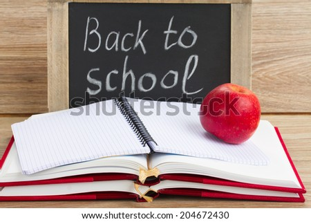 black chalk board with back to school letters and school supplies - stock photo