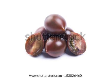 black cherry tomatoes isolated on white background - stock photo
