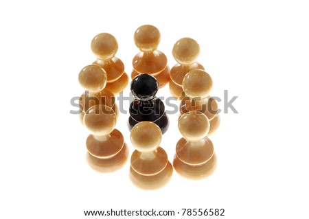 black chess figure surrounded with white ones, isolated on white background - stock photo