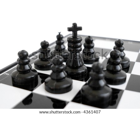 Black chess king stands on a chess board with figures - stock photo