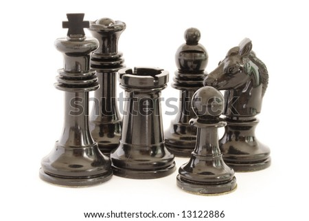 Black chess pieces on a white background - stock photo