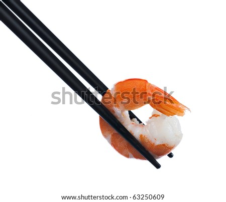 Black chopsticks holding a prawn on white background