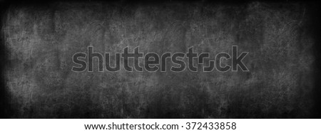 Black Classroom Blackboard Background. Chalk Erased School Chalkboard Vintage Texture. Long format - stock photo