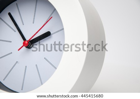 Black clock isolated on a white background - stock photo