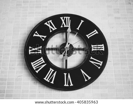 Black Clock on white mosaics