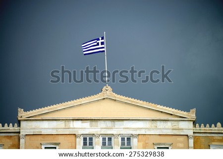Black cloud over Hellenic Parliament, Athens, Greece - stock photo