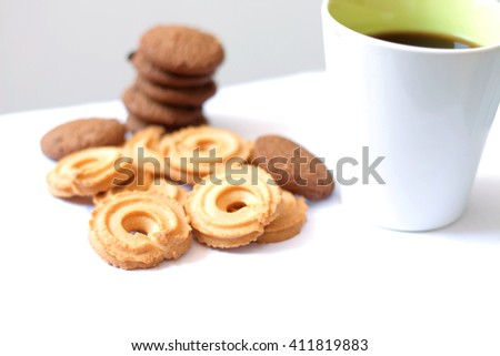 black coffee and cookies soft focus
