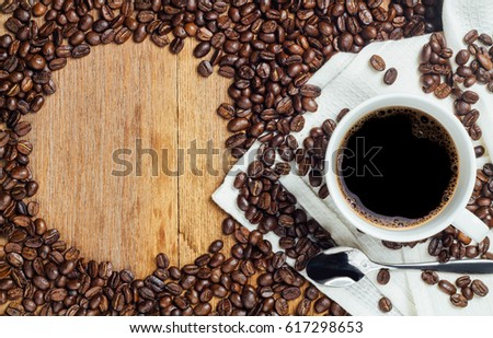 black coffee bean and white cup, brown wood table