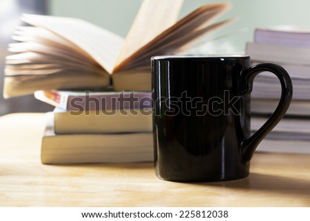 black coffee cup and book pile - stock photo