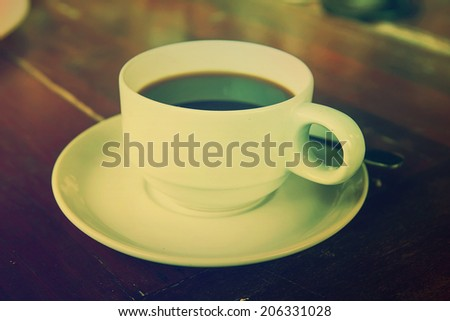 Black coffee in a white cup on the table. - stock photo