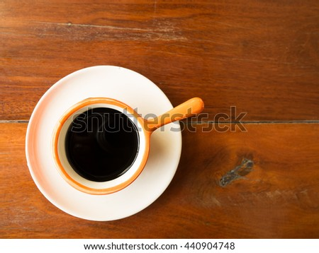 Black coffee in clay pot cup with space for text