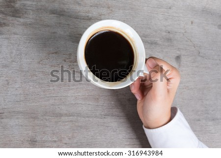 Black Coffee in hand - stock photo
