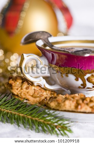 Black coffee in the china cup and biscuits on the Christmas time