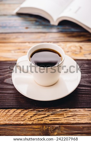 Black coffee in white cup in coffee shop - Vintage effect pictures style