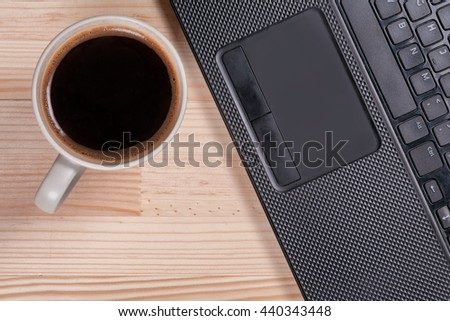 Black coffee laptop notebook business generic phone natural wooden light background top view
