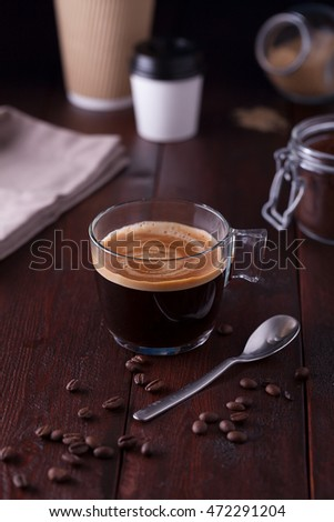 Black coffee on a dark wooden table