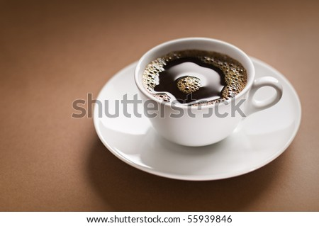 Black coffee on brown background close up shoot - stock photo
