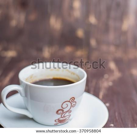 Black coffee on wood background - stock photo