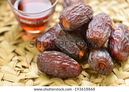 Black coffee with dates close up - stock photo