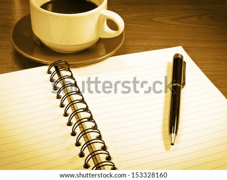 black coffee with notebook and pen - stock photo