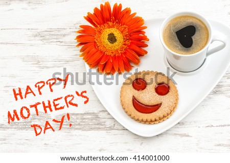 Black coffee with smiled cookie. Heart, love, flower. Happy Mothers Day! Mothers Day breakfast. Mothers Day greetings card. Mothers Day concept. Mother's Day. Mothers Day gift - stock photo
