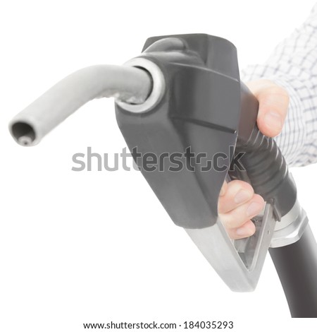 Black color gun from the fuel pump in hand and isolated on white - 1 to 1 ratio