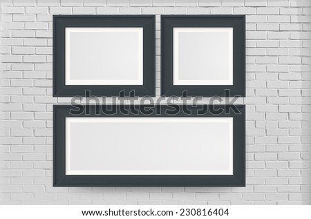 Black color photo frames mount on wall - stock photo