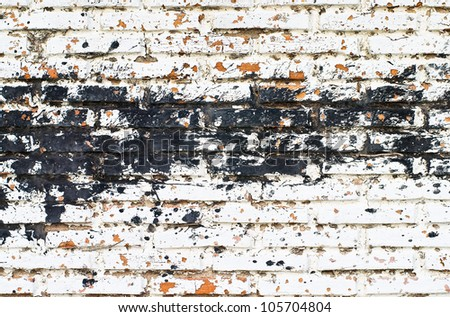 black color splash on white brick wall - stock photo