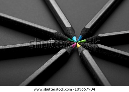 black, colored pencils, on black background - stock photo