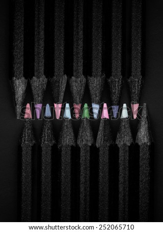 black, colored pencils, on black background, pastel colors - stock photo