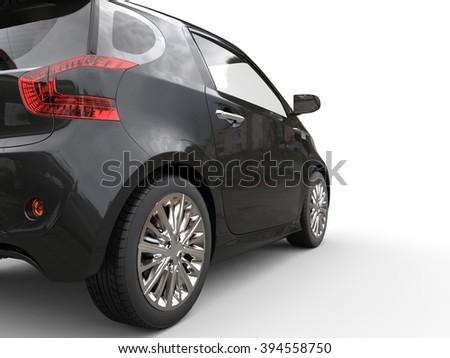 Black Compact Car - Taillight Closeup View - stock photo
