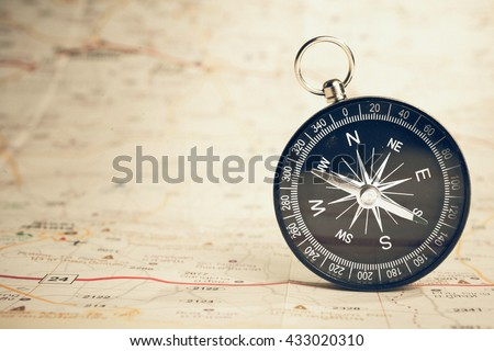 Black compass on highway map - stock photo