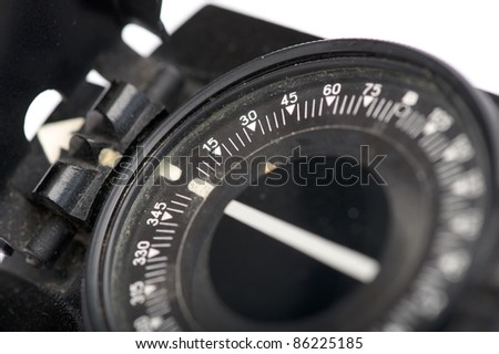 Black compass on the white background