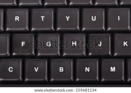 Black computer keyboard buttons, top view. - stock photo