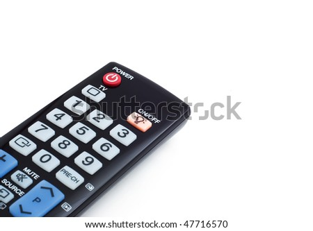 black controller from the TV to the power button, a white background, shallow depth of field - stock photo