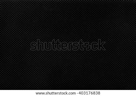 Black corrugated plastic texture useful as a background
