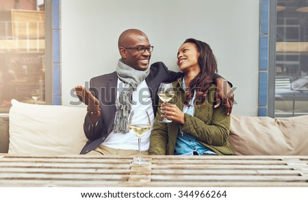 Black couple on a date enjoying a glass og wine - stock photo