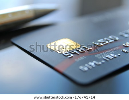 Black credit card with ball pen - stock photo