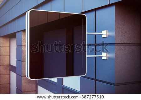 Black cristal digital screen on the bulding city. Concrete facades of modern buildings in background. Horizontal mockup, blurred. 3d render