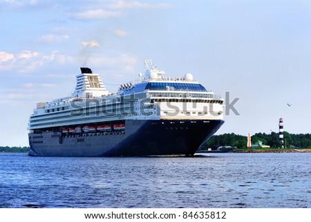 black cruise liner leaving the port of Riga - stock photo